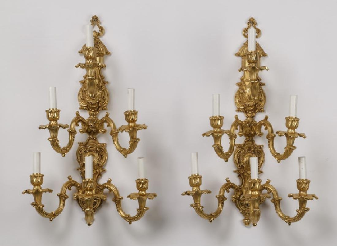 Pair of Continental Rococo style gilt bronze sconces