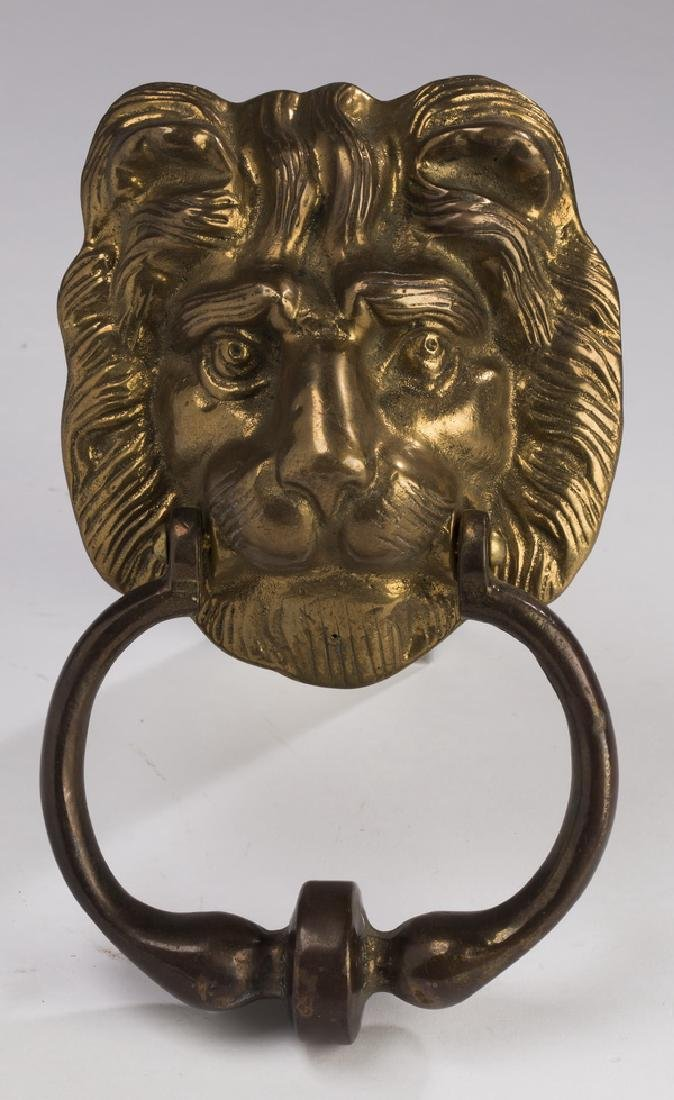 Figural brass lion's mask door knocker with ring