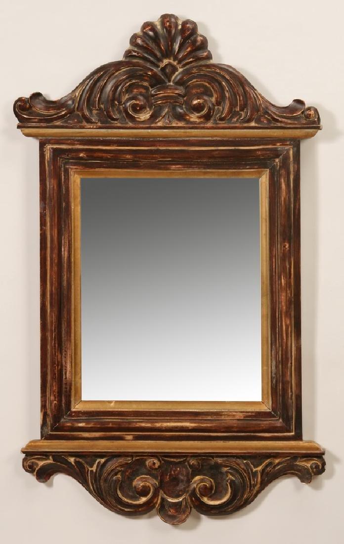 "Carved and parcel gilt beveled mirror, 39""h"