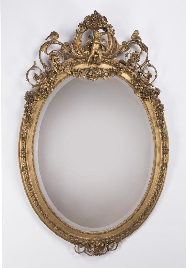 "Louis XV style oval gilt wood beveled mirror, 64""h"