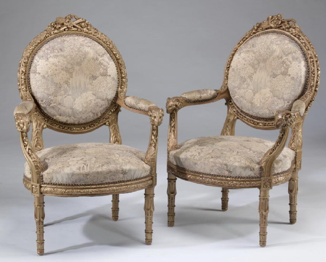 (2) Louis XVI style carved fauteuils, after Amaury