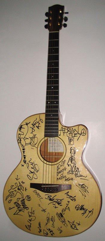 24: An Avalon guitar signed by Robert Plant, Blur etc