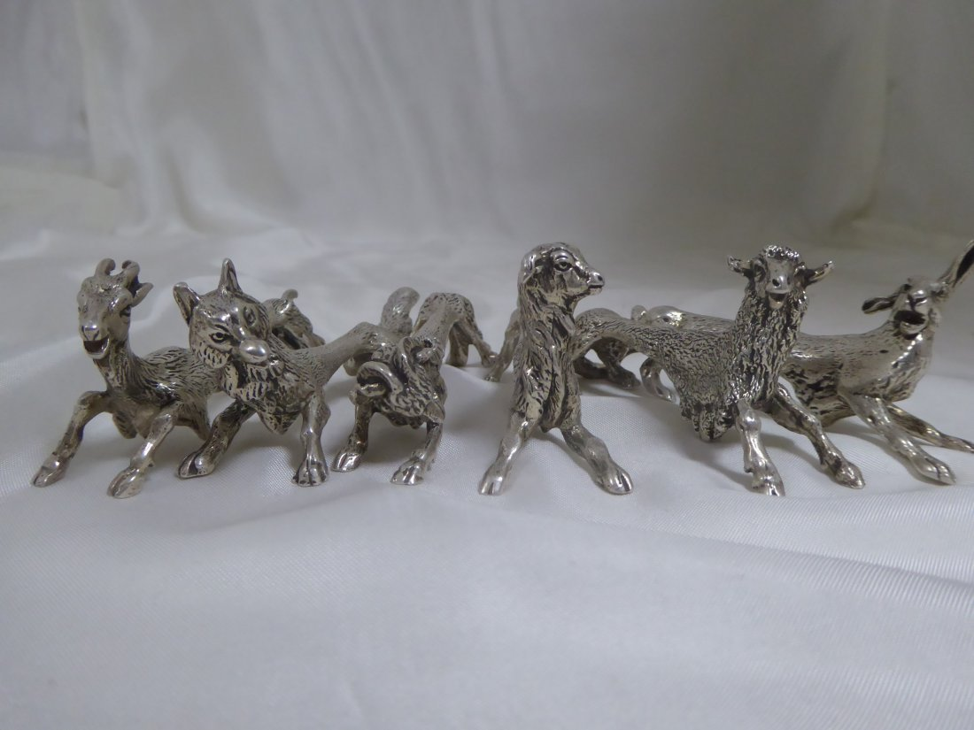 12 animal-shaped knife rests in solid silver