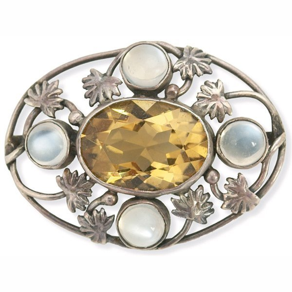 183: Arts & Crafts pin, oval shape with leaf designs