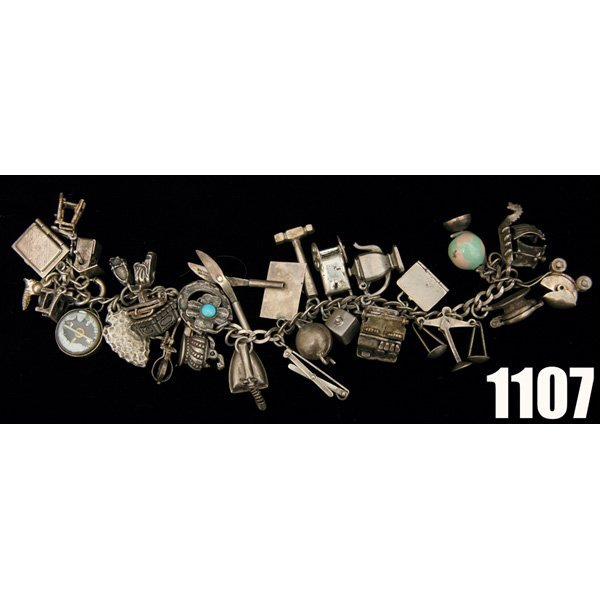 1107: Vintage Antique Sterling charm bracelet with thir