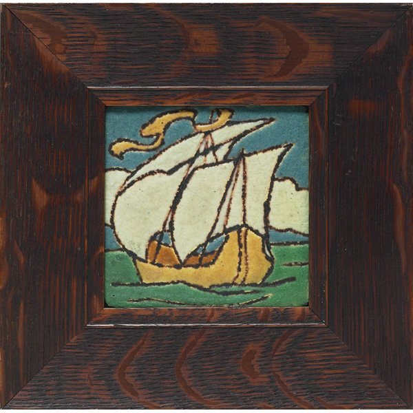 19: Grueby tile, colorful carved and painted ship desig