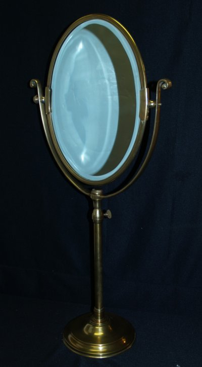 4: BRASS BEVELLED OVAL GLASS MIRROR ON STAND