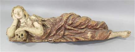Carving of Magdalene Reclining Holding a Skull