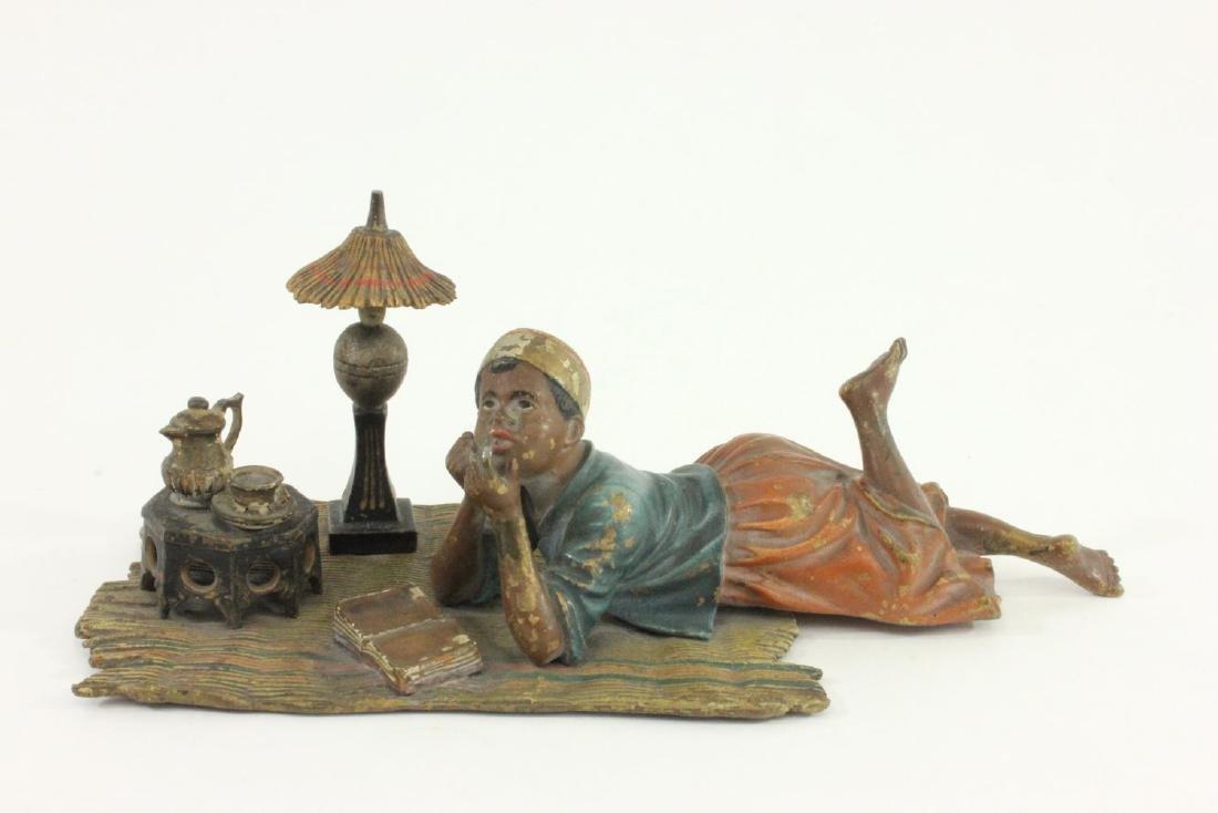 Viennese Bronze Reclining Boy on Carpet