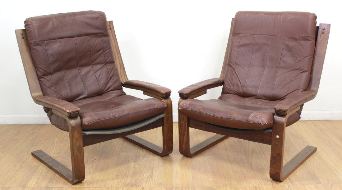 2 Mid-Century Modern Brown Leather Armchairs