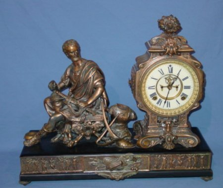 219: LATE 19TH C. ANSONIA FIGURAL METAL MANTLE CLOCK