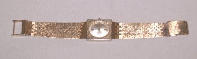 792A: 14KT GOLD JULES JURGENSON WRIST WATCH