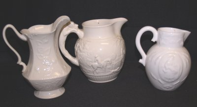 803: 3 CREAM COLORED PITCHERS