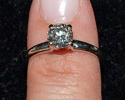 605: JEWELRY. 14KT WHITE GOLD SOLITAIRE DIAMOND RING