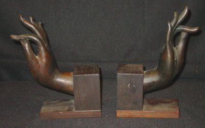 37: BRONZE & WOOD BOOKENDS IN HAND FORM