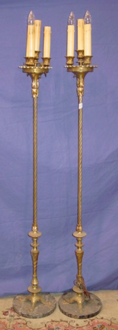 551: PAIR IRON STANDING 4 LIGHT TORCHIERE LAMPS