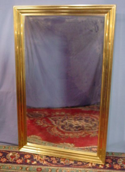 33: CONTEMPORARY BRASS FRAMED MIRROR