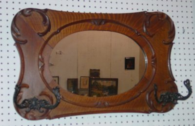 35: CARVED OAK MIRROR WITH HAT HOOKS