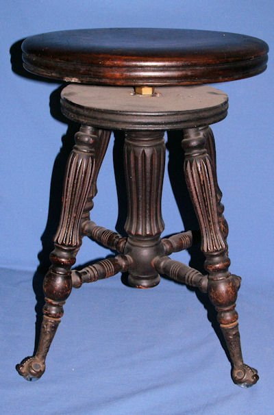 23: MAHOGANY GLASS BALL & CLAW PIANO STOOL