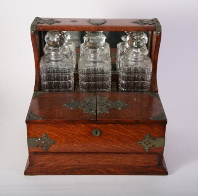 43: LATE 19TH C. OAK LIQUOR SET WITH BRASS STRAPS