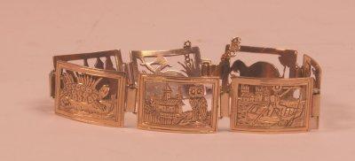 515A: GOLD 7 PANEL BRACELET FROM HONDURAS