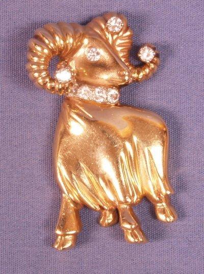 517: 14KT GOLD RAM PIN WITH DIAMOND HORN