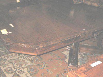 695: BERKEY & GAY BANDED WALNUT DINING ROOM TABLE