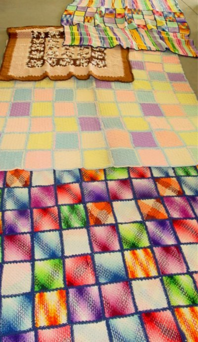 2: Four large multi colored quilts