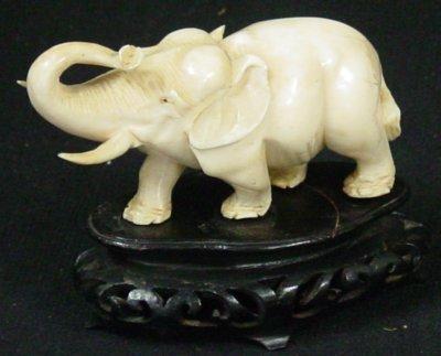 7: Carved elephant on wood base