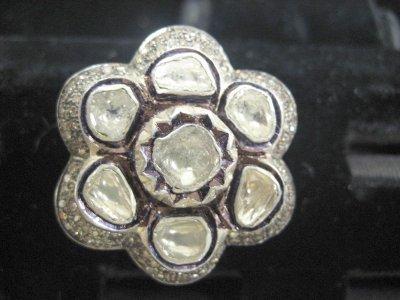 612: Gold, silver & rose cut diamond flower ring