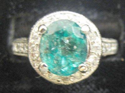 620: White gold, diamond & emerald oval ring