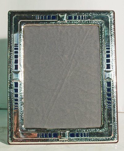 602: Sterling silver frame with blue enameling