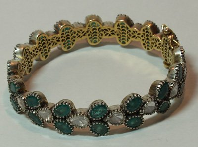 614: Gold, silver, emerald & diamond bracelet
