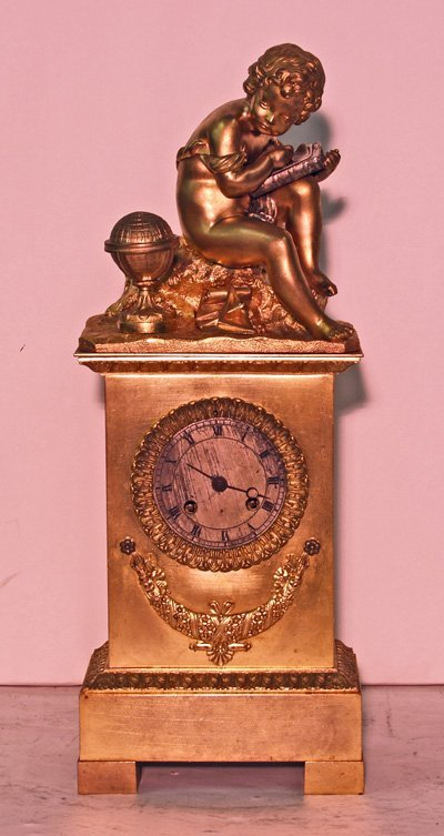 717: Antique French bronze figural clock with cupid