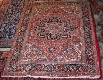 1A: Red center medallion floral rug