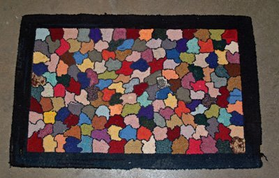 4A: 5 assorted hooked, hand loomed scatter rugs