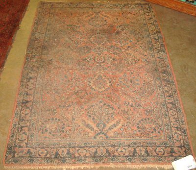 1008: Early 20th c. Red Sarouk Persian rug