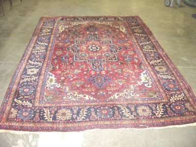 1009: Sarouk red center medallion rug