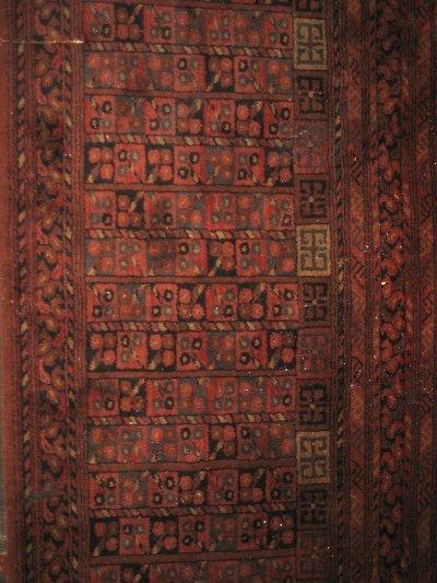 1013A: Buhkara style machine made rug