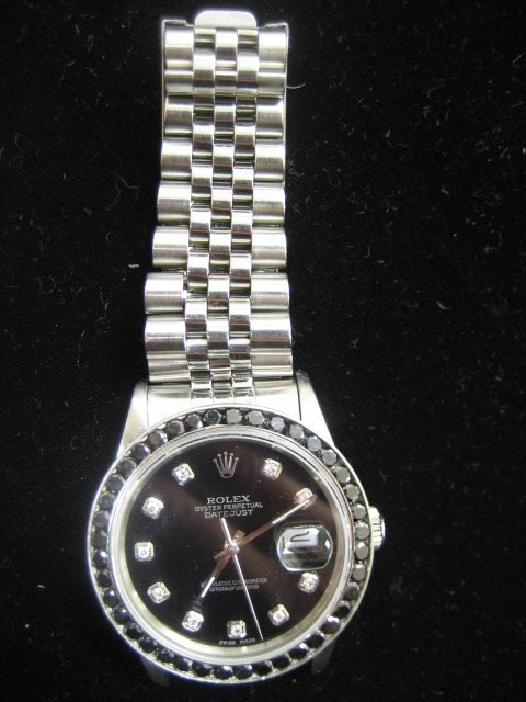 583: Rolex Mens Watch with diamonds
