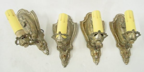 599: Four single brass sconces
