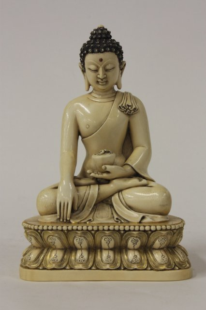 930: Ivory seated Tibetan Buddha