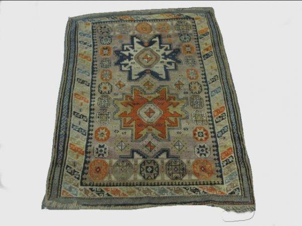4: Antique ivory Caucasian rug