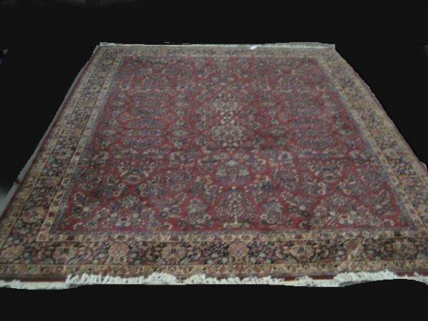 9: Red Karastan rug with floral design
