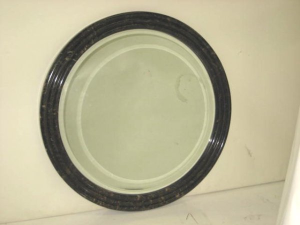 16: Round bevelled faux marble framed mirror