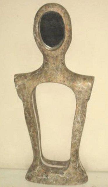20: Modern sculpture with mirrored head