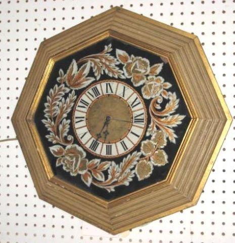 23: Reverse painted gilt framed clock
