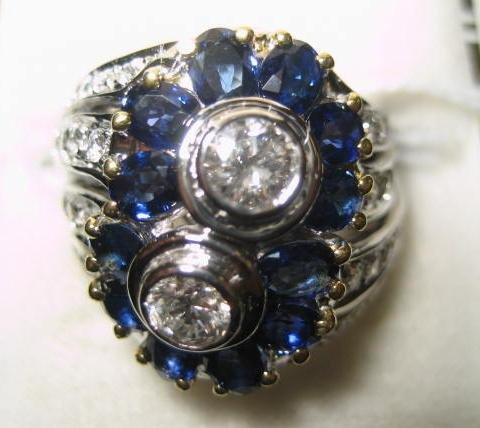 547: 18kt white gold, diamond & sapphire ladies ring