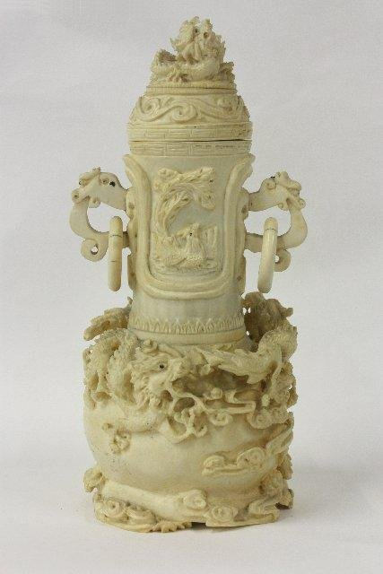 583: Carved ivory urn with two handles
