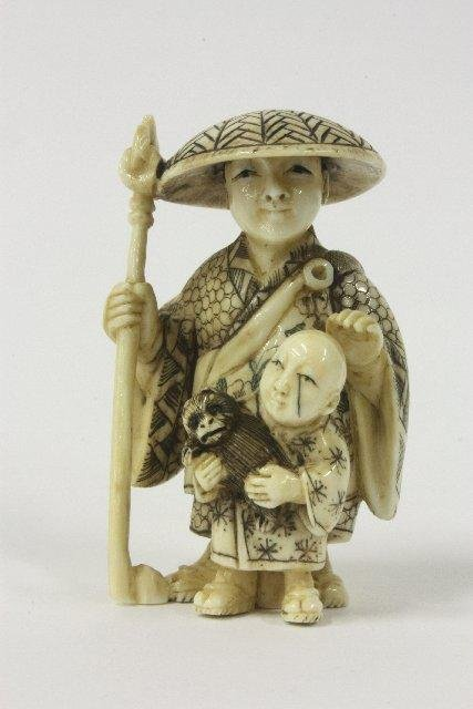 "586: Netsuke ""Lady in Hat with Child Holding a Monkey"""
